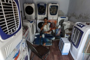 An air conditioning salesman, one of few happy people in Ahmedabad. Credit: Divyakant Solanki / EPA