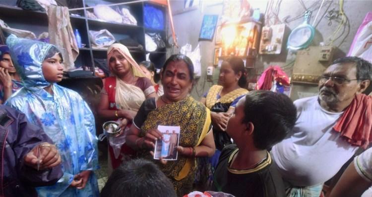 Wailing family members of  illicit liquor victims at a  slum area of Malvani, Malad on Thursday. PTI Photo by Santosh Hirlekar