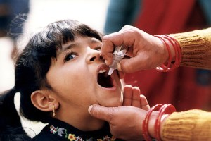 A little girl receiving an oral polio vaccine in India in 2011. Credit: cdcglobal/Flickr, CC BY 2.0