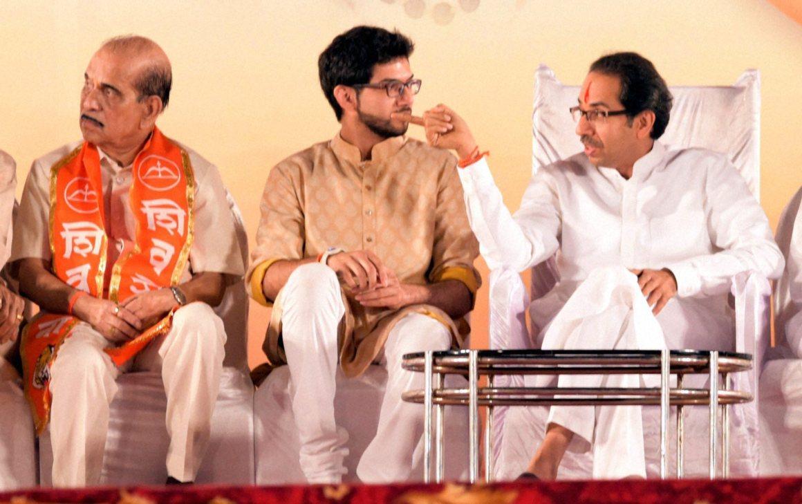 Shiv Sena president Uddhav Thackeray with son Aditya Thackeray during the Dasara rally in Mumbai on Thursday. Credit: PTI Photo by Santosh Hirlekar