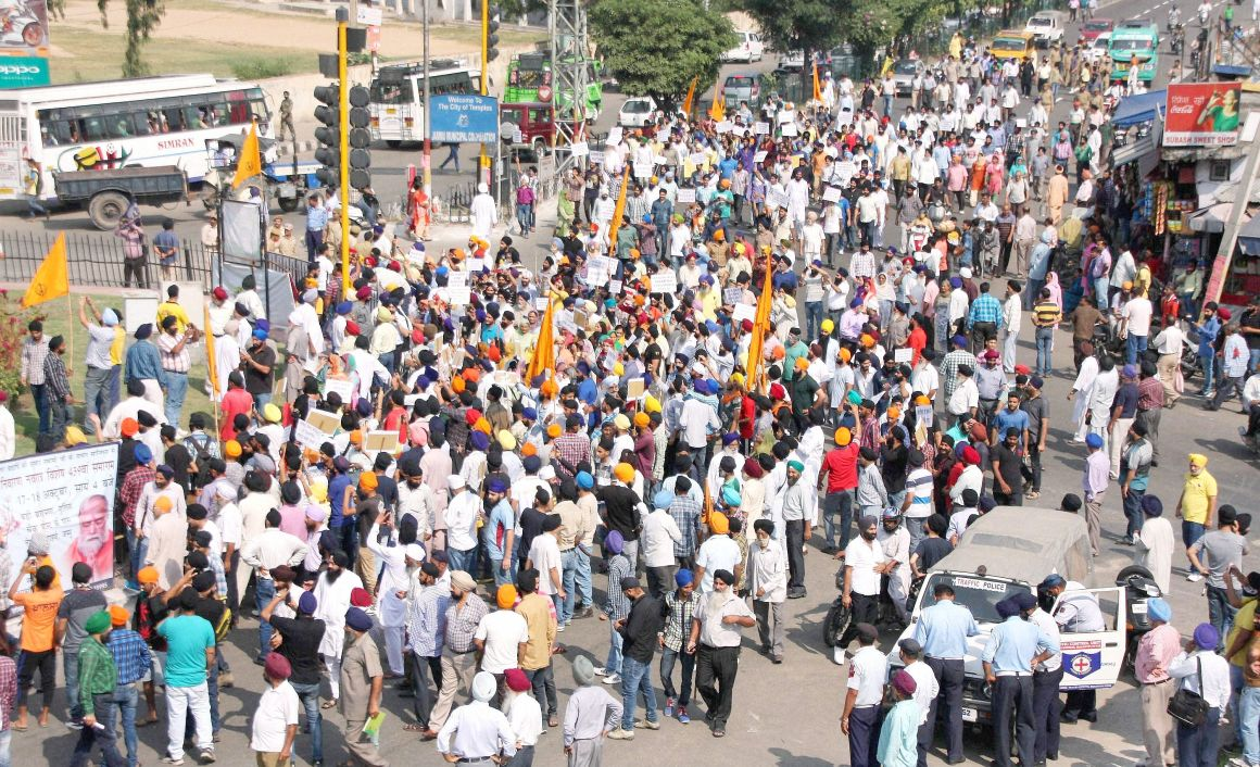 Sikh groups blocked Jammu-Pathankot National Highway protest against the Punjab Chief Minister Parkash Singh Badal following the alleged desecration of the Guru Granth Sahib in Jammu on Saturday. Credit: PTI Photo