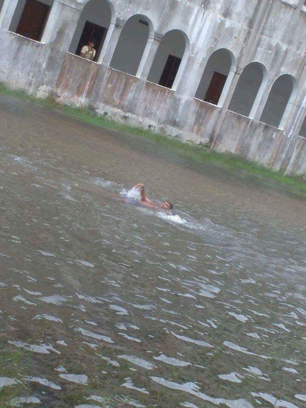 A man swims in the inundated grounds of a college campus along Old Mahabalipuram Road, Chennai. Credit: Emmanuel