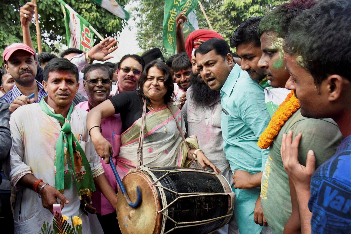 JD(U) supporters celebrate the Mahagathbandhan's (Grand Alliance) victory in the Bihar assembly elections at the party office in Patna on Sunday. Credit: PTI