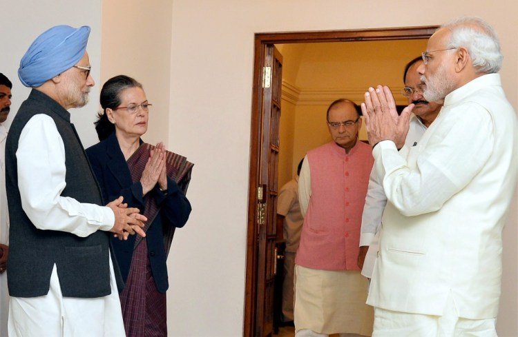 Prime Minister Narendra Modi greets former prime minister Manmohan Singh and Congress President Sonia Gandhi at 7 Race Course Road in New Delhi on Friday. Union Finance Minister Arun Jaitley and Union Minister of Urban Development M Venkaiah Naidu are also seen. Credit: PTI