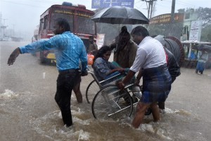 Patients being shifted from a flooded hospital after heavy rains in Chennai on Tuesday. Credit: PTI