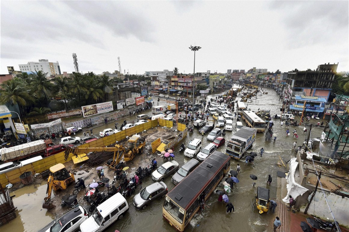 Vehicles navigating a water-lodged road during heavy rains in Chennai on December 2. Credit: PTI