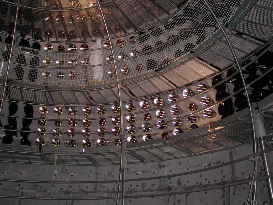 Inside the Borexino neutrino detector, during construction, in 2001. The photomultiplier tubes are visible. Credit: Borexino