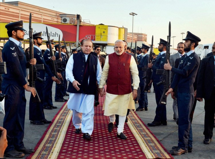 Prime Minister Narendra Modi is received by his Pakistani counterpart Nawaz Sharif upon his arrival in Lahore on Friday. Credit: PTI Photo