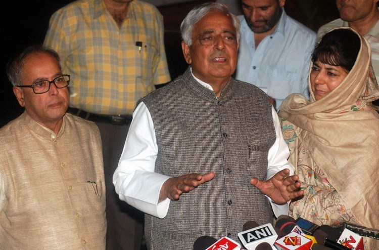 File photo of Mufti Mohammad Sayeed with his daughter Mehbooba Mufti and then Defence Minister Pranab Mukharjee after a meeting with UPA Chairperson Sonia Gandhi in New Delhi in October 2005. Mufti Mohammad Sayeed passed away at AIIMS in New Delhi on Thursday . Credit: PTI