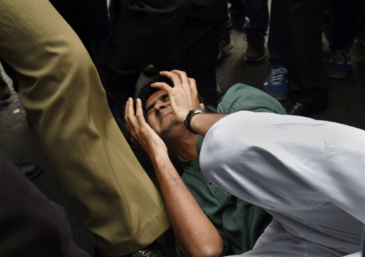 New Delhi: A JNU student being beaten up by lawyers outside the Patiala House courts in New Delhi on Monday. The students were attacked for protesting the arrest of JNUSU president Kanhaiya Kumar. Credit: PTI Photo by Atul Yadav
