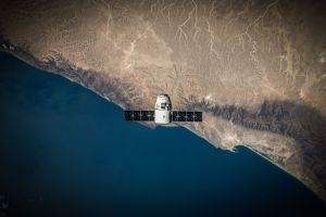 A SpaceX Dragon capsule in orbit around Earth, as part of the CRS-5 mission. Credit: SpaceX
