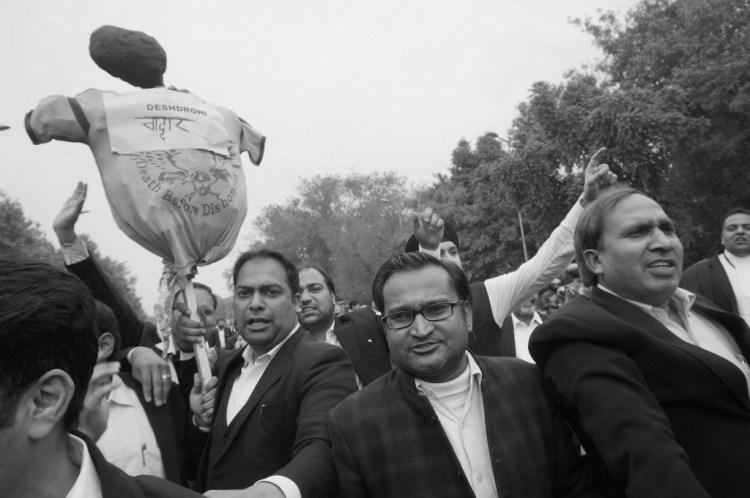 Lawyers hold aloft the effigy of a 'ghaddaar' or traitor. Credit: Shome Basu