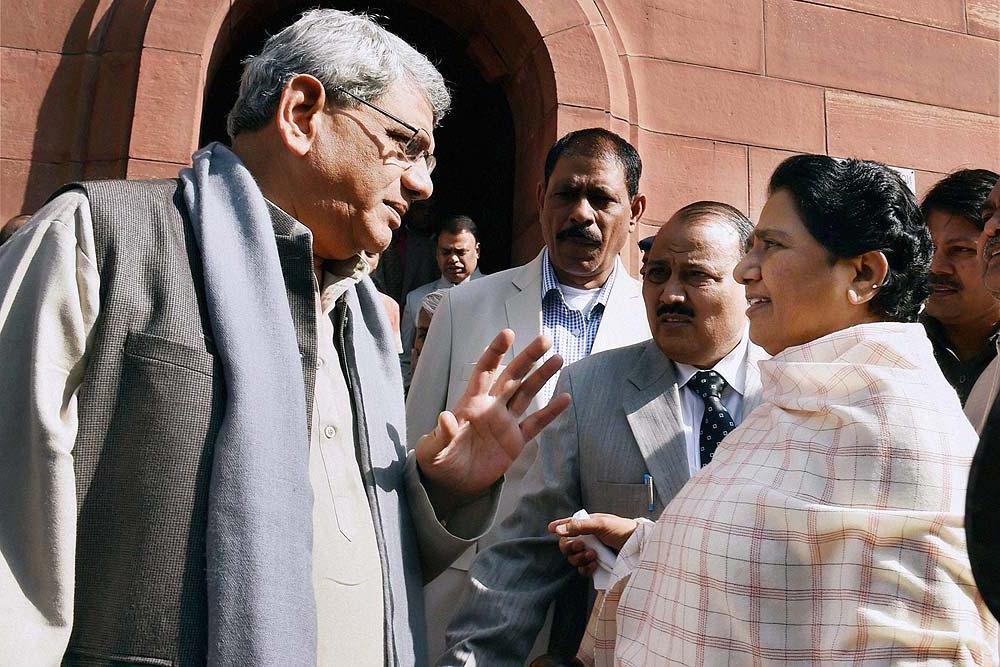 CPM leader Sitaram Yechury and BSP leader Mayawati outside Parliament. Credit: PTI