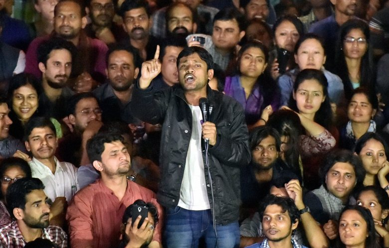 JNUSU President Kanhaiya Kumar addresses students after reaching the JNU campus upon his release on bail, in New Delhi on Thursday. Credit: PTI Photo by Kamal Singh