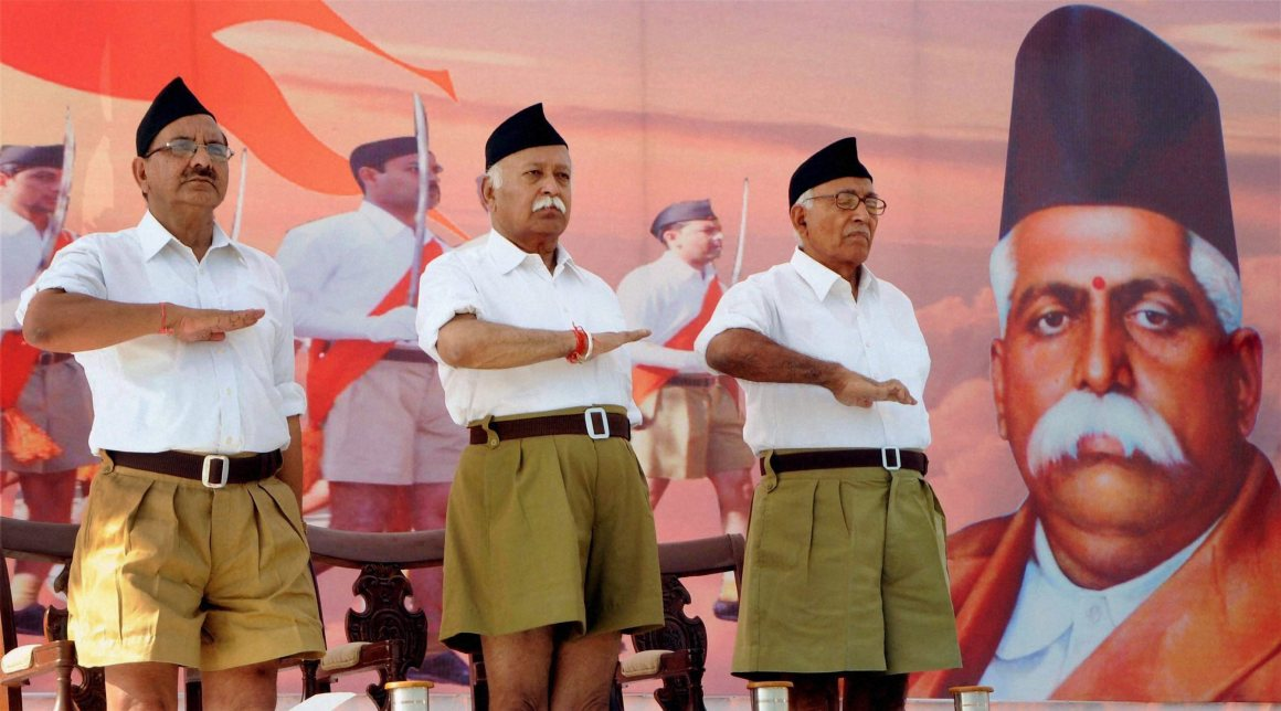 File photo of RSS Chief Mohan Bhagwat (C) during the RSS function. Credit: PTI