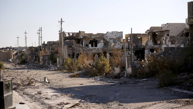 Destroyed buildings are seen in the city of Ramadi, in this January 16, 2016 file photo. REUTERS/Thaier Al-Sudani/Files