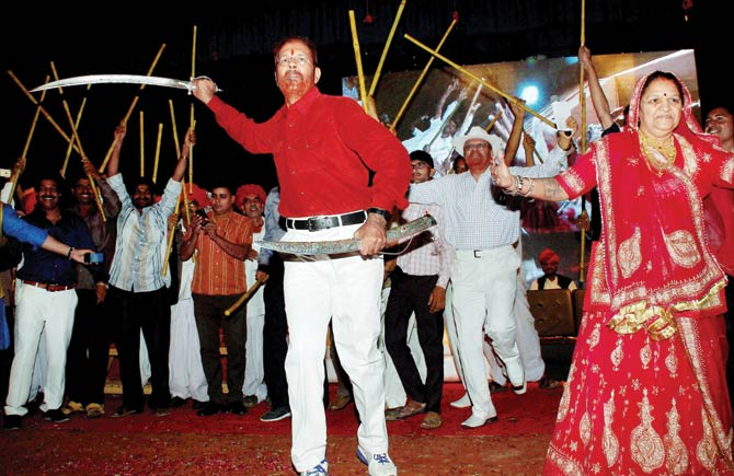 Former IPS officer D.G. Vanzara dances with a sword during a welcome ceremony by his family and community in Gandhinagar on April 8. Credit: PTI