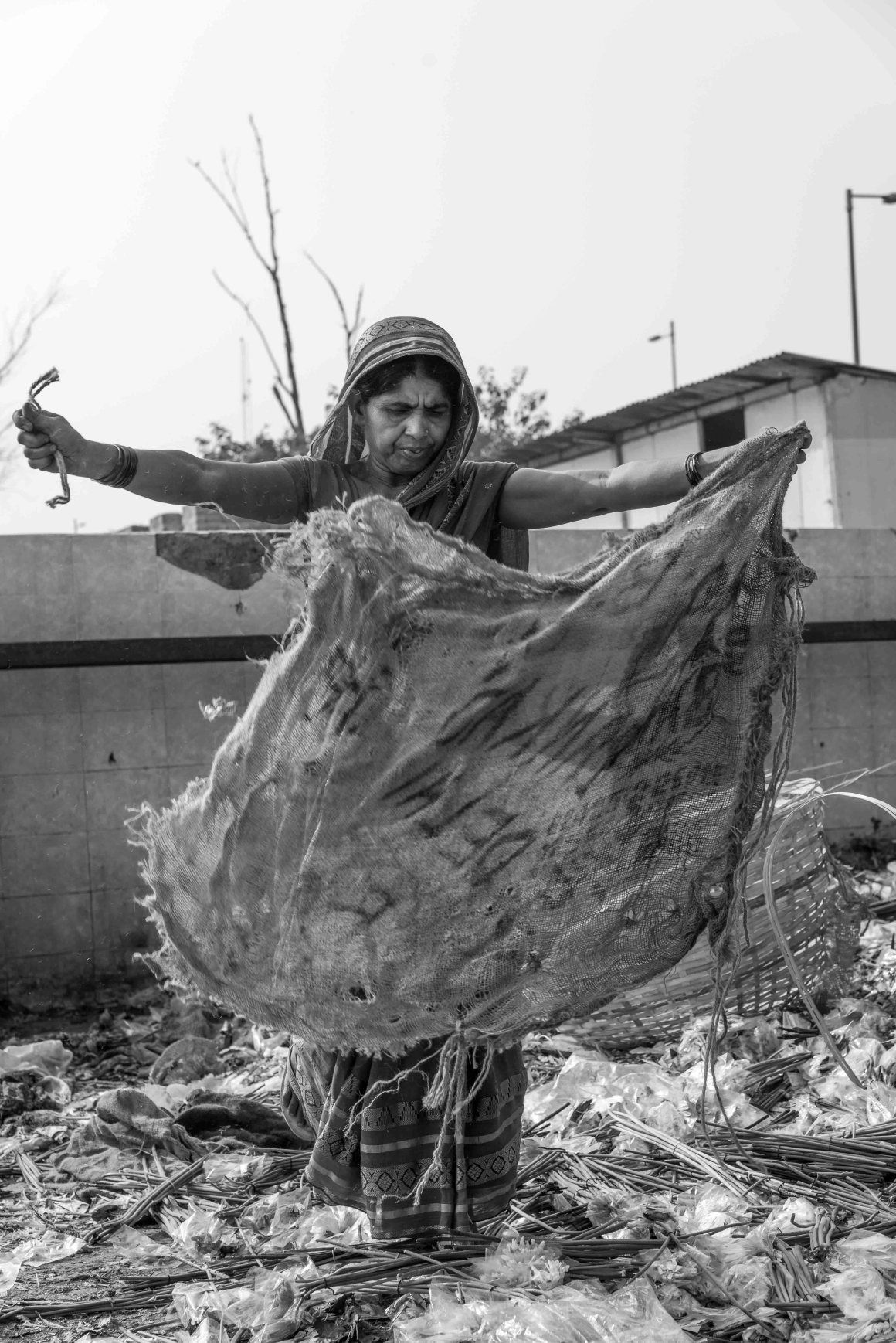 "These women collect the waste flowers left to be thrown out each morning at Gazipur market, and turn them into paper, cards and notebooks to sell. The photographer dedicates his images to ""women who make something out of nothing."""