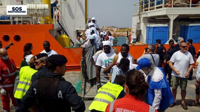 Migrants disembark from the SOS Mediterranee ship Aquarius at the Italian island of Lampedusa. Credit: Reuters