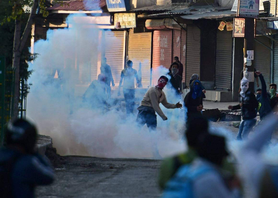 Kashmiri youth hurl stones during clashes with security forces near Srinagar last week. Credit: PTI