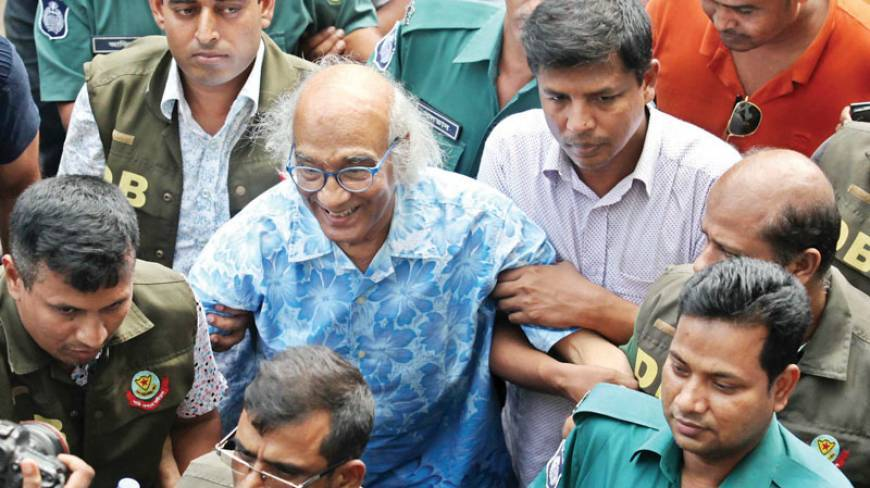 Senior journalist Shafik Rahman being led away by the police in Dhaka last week. Credit: Dhaka Tribune