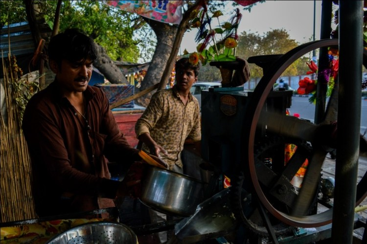 Roopchandra sells sugar cane juice to earn his living. Credit: Mirza Arif Beg