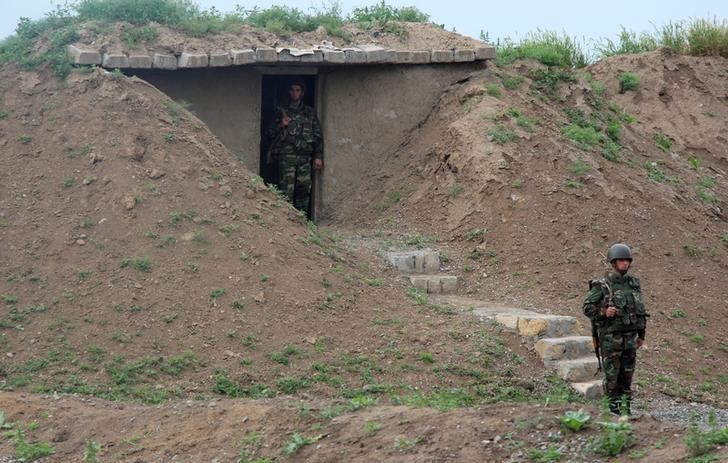 Azeri servicemen guard their position at the frontline with the self-defense army of Nagorno-Karabakh in Azerbaijan, April 29, 2016. Credit: Reuters/Zulfiya Safkhanova