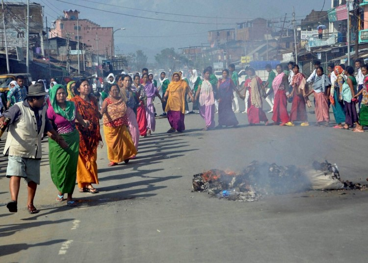 Imphal: Women activists of Joint Committee on Inner Line Permit System stage a protest at Khurai Lamlong on Monday demanding implementation of Inner line permit system in the state and also the release of students arrested by Manipur police. Credit: PTI
