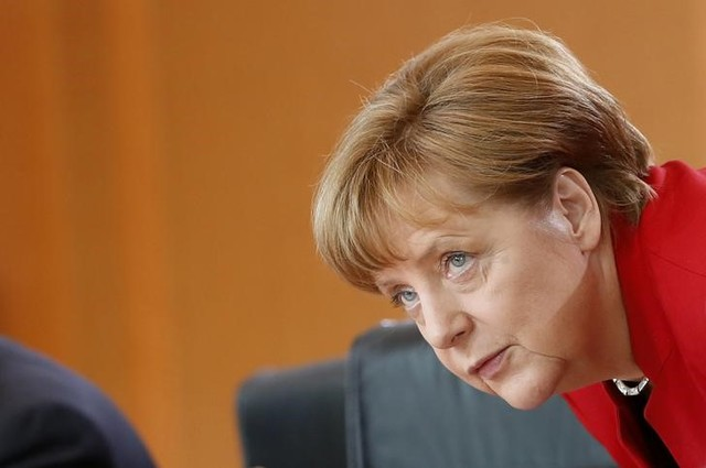 German Chancellor Angela Merkel takes her seat during a cabinet meeting at the Chancellery in Berlin, Germany, May 18, 2016. Credit: Reuters/Fabrizio Bensch