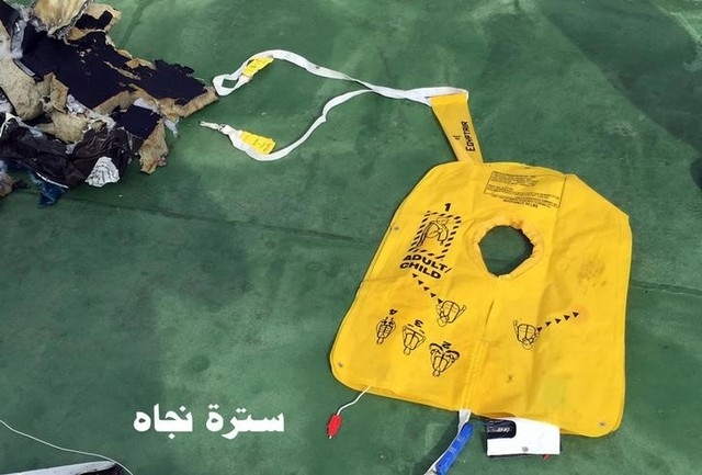 """Recovered debris of the EgyptAir jet that crashed in the Mediterranean Sea is seen with the Arabic caption """"life jacket"""" in this handout image released May 21, 2016 by Egypt's military. Credit: Egyptian Military/Handout via Reuters"""
