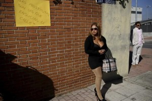 "A sex worker (C) stages a performance to denounce what they say is abuse and social stigma against them in Madrid, Spain, October 14, 2015. Placard reads ""Prostitutes are the ones that make the streets dirty"". Credit: Reuters/Andrea Comas/Files"