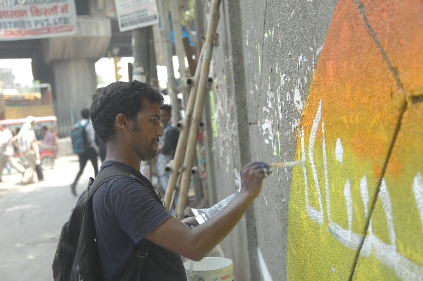 Akhlaq Ahmad at work on the Urdu couplet. Credit: Delhi, I Love You