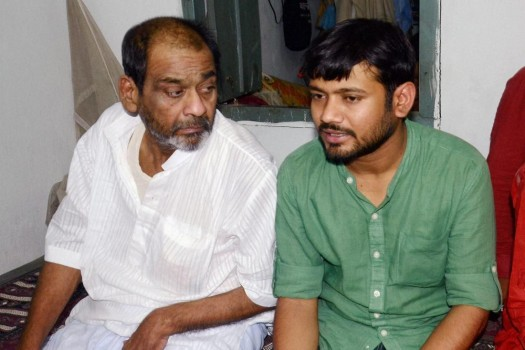 Kanhaiya Kumar with his father in Patna. Credit: PTI