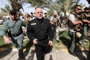 Iraq's Prime Minister Haider al-Abadi (front 2nd L) walks during his visit to an Iraqi army base in Camp Tariq near Falluja, Iraq, June 1, 2016. Credit: Reuters/Alaa Al-Marjani/File Photo