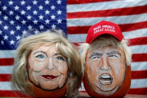 The images of US Democratic presidential candidate Hillary Clinton (L) and Republican Presidential candidate Donald Trump are seen painted on decorative pumpkins created by artist John Kettman in LaSalle, Illinois, US, June 8, 2016. Credit: Reuters/Jim Young