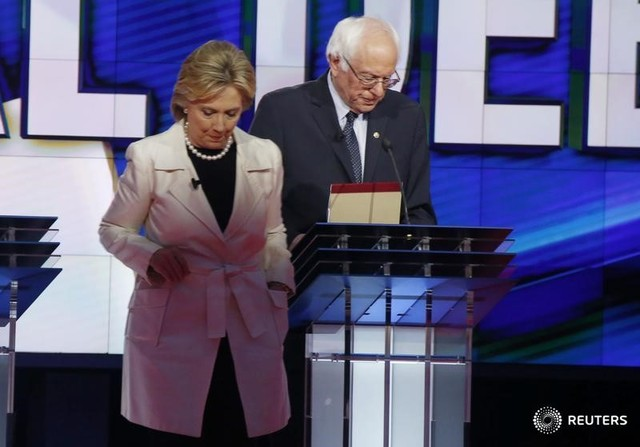 Democratic US presidential candidate Hillary Clinton (L) and rival Bernie Sanders leave their podiums at the conclusion of the Democratic debate hosted by CNN and New York One at the Brooklyn Navy Yard in New York April 14, 2016. Credit: Reuters/Lucas Jackson