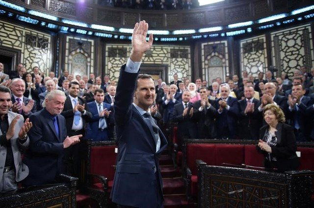 Syria's president Bashar al-Assad gestures while parliament members clap in Damascus, Syria in this handout picture provided by SANA on June 7, 2016. Credit: SANA/Handout via Reuters