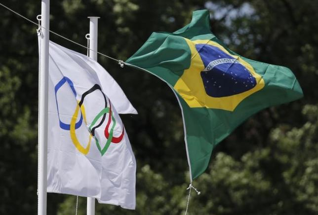 The Olympic and the Brazilian flag fly over the site of ancient Olympia during the Olympic flame lighting ceremony for the Rio 2016 Olympic Games, Greece, April 21, 2016. Credit: Reuters/Alkis Konstantinidis