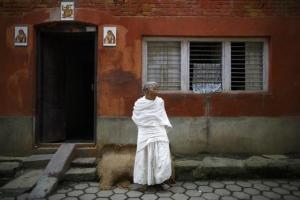 A widow stands outside a house in Lalitpur August 18, 2014. Credit: Reuters/ Navesh Chitrakar/Files