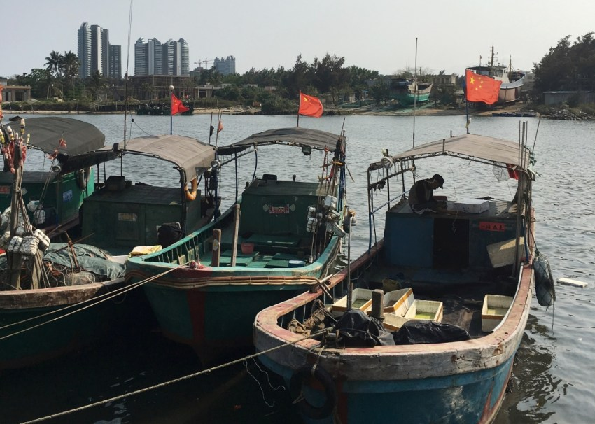 Fishing boats with Chinese national flags are seen at a harbour in Tanmen, Hainan province, April 5, 2016. Reuters/Megha Rajagopalan.