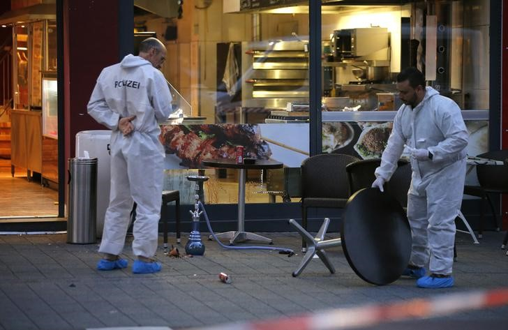 Police forensic experts work outside where a 21-year-old Syrian refugee killed a woman with a machete and injured two other people in the city of Reutlingen, Germany July 24, 2016. Reuters/Files