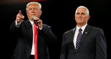 Republican presidential candidate Donald Trump (L) and vice presidential candidate Mike Pence speak at a campaign event in Roanoke, Virginia, U.S., July 25, 2016. Credit: REUTERS/Carlo Allegri