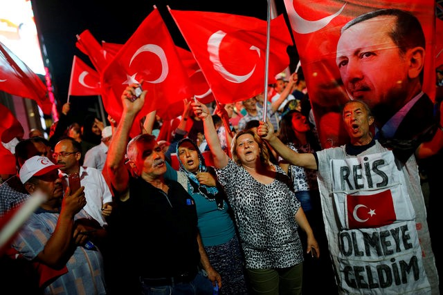 People shout slogans and wave Turkish national flags as they have gathered in solidarity night after night since the July 15 coup attempt in central Ankara, Turkey, July 27, 2016. Credits: REUTERS/Umit Bektas