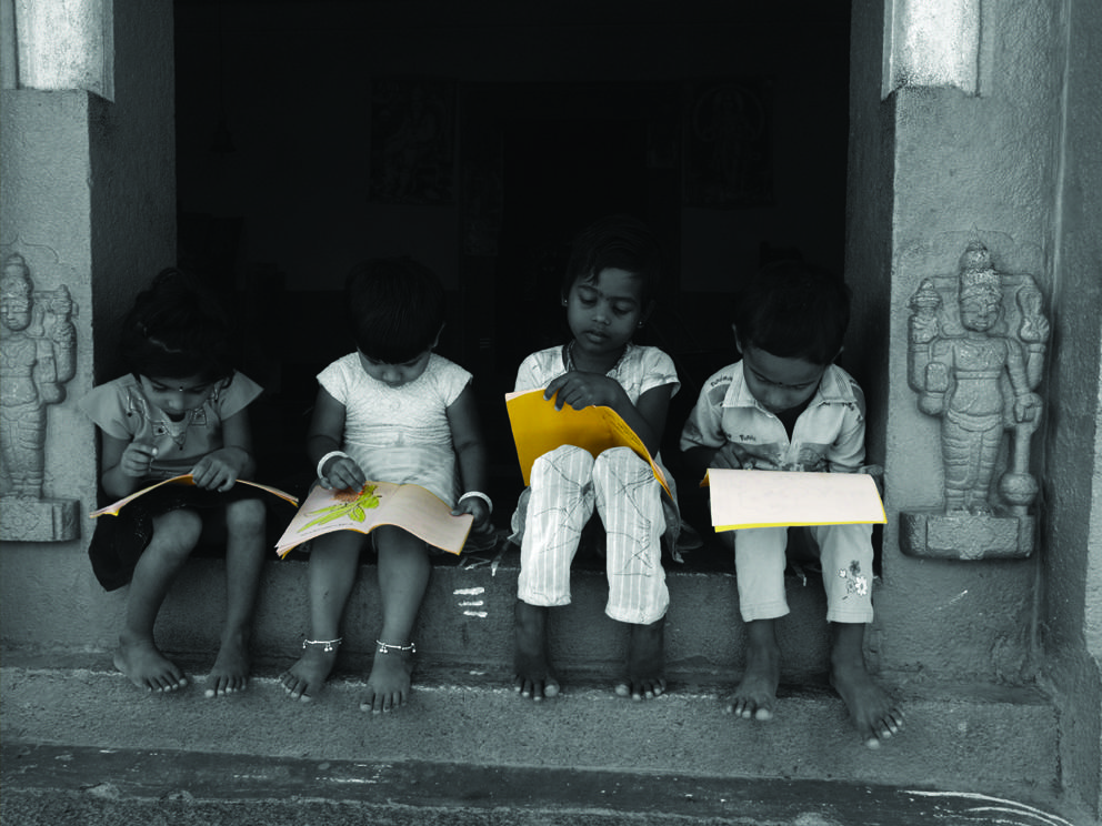 Some children holding languages textbooks. Credit: prathambooks/Flickr, CC BY 2.0