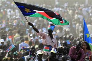 A man waves South Sudan's national flag as he attends the Independence Day celebrations in the capital Juba, July 9, 2011. Credit: Reuters/Thomas Mukoya/Files