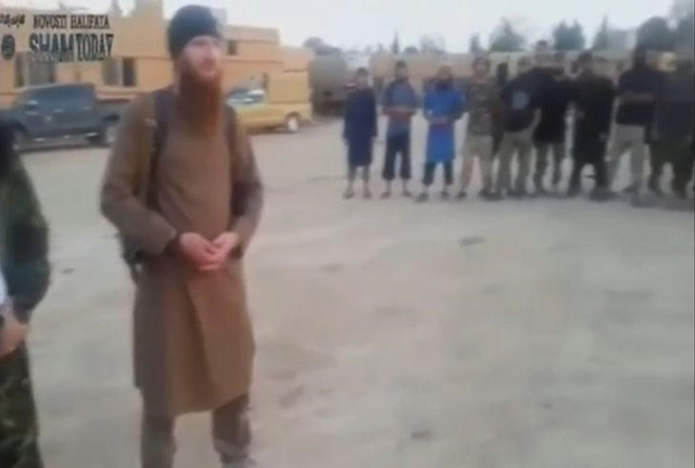 A still image taken on July 14, 2016 from an undated video posted on social media, shows Islamic State senior operative Abu Omar al-Shishani stands with fighters in Al Hasakah, Syria. Social Media
