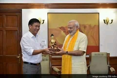 Newly appointed Arunachal Pradesh chief minister Pema Khandu gifting a Buddha statue to Prime Minister Modi on Sunday. Credit: PIB