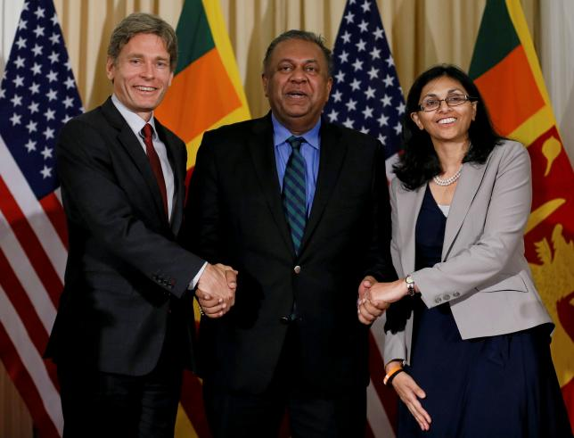 Nisha Biswal, US assistant secretary of state for South and Central Asian affairs (R) and Tom Malinowski, assistant secretary of state for democracy and human rights (L) shake hands with Sri Lanka's minister of foreign affairs Mangala Samaraweera during their meeting in Colombo, Sri Lanka July 12, 2016. Credit: REUTERS/Dinuka Liyanawatte