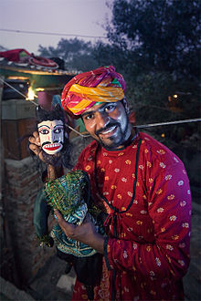 A resident of Kathputli colony with his puppet. Credit: Wikipedia