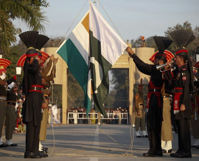Pakistan Rangers (R) and Indian Border Security Force personnel take part in the daily flag lowering ceremony at their joint border post of Wagah near Lahore and Amritsar. Credit: Reuters/Mohsin Raza